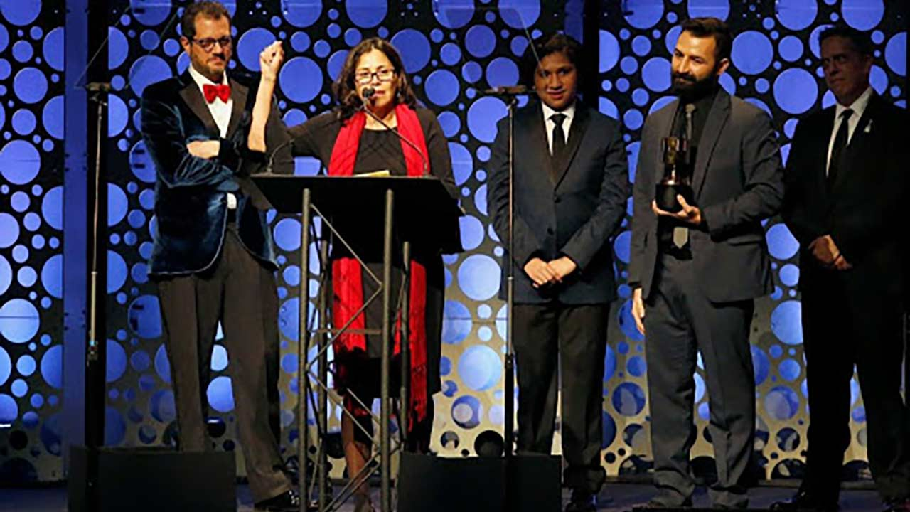 group of people on stage at award show