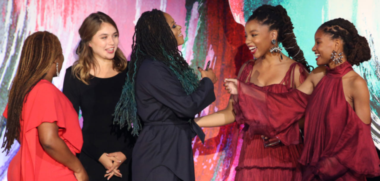 five women on stage at awards ceremony